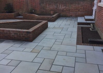 Patio with Raised Brick Flower Beds in Southsea